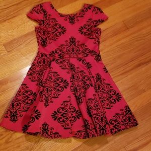 Girls black flocked red dress size 10. Worn once.